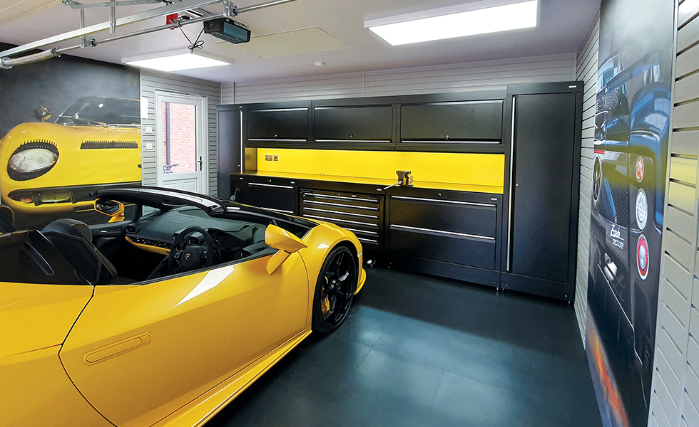 Themed garage with Dura cabinets and wall art for Lamborghini owner