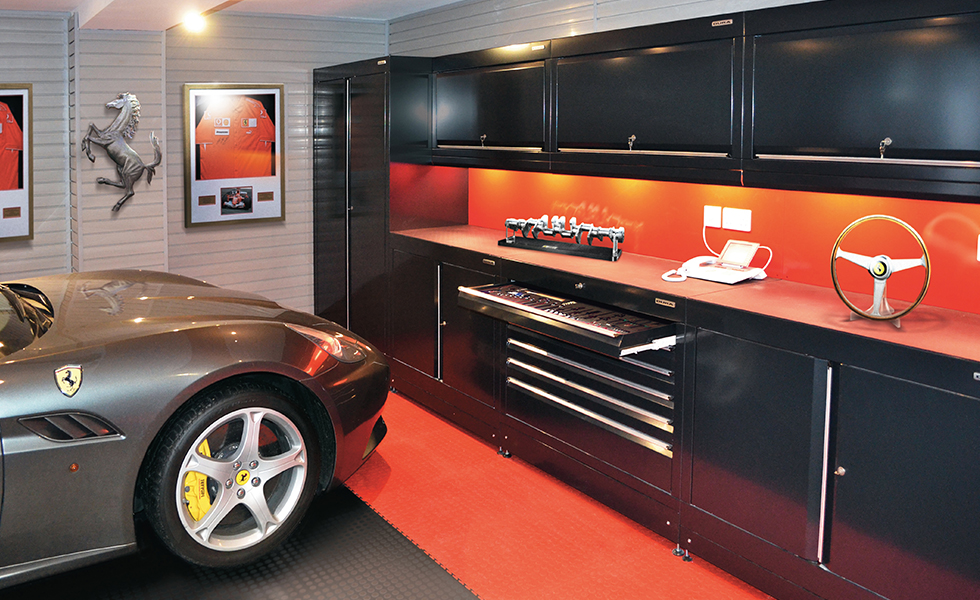 Themed garage with Dura cabinets and flooring for Ferrari owner