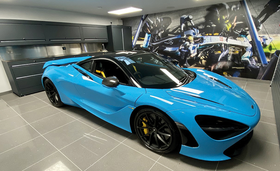 Double garage with Dura cabinets for McLaren owner