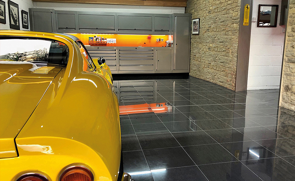 Stone built garage with Dura cabinets for Ferrari Dino owner