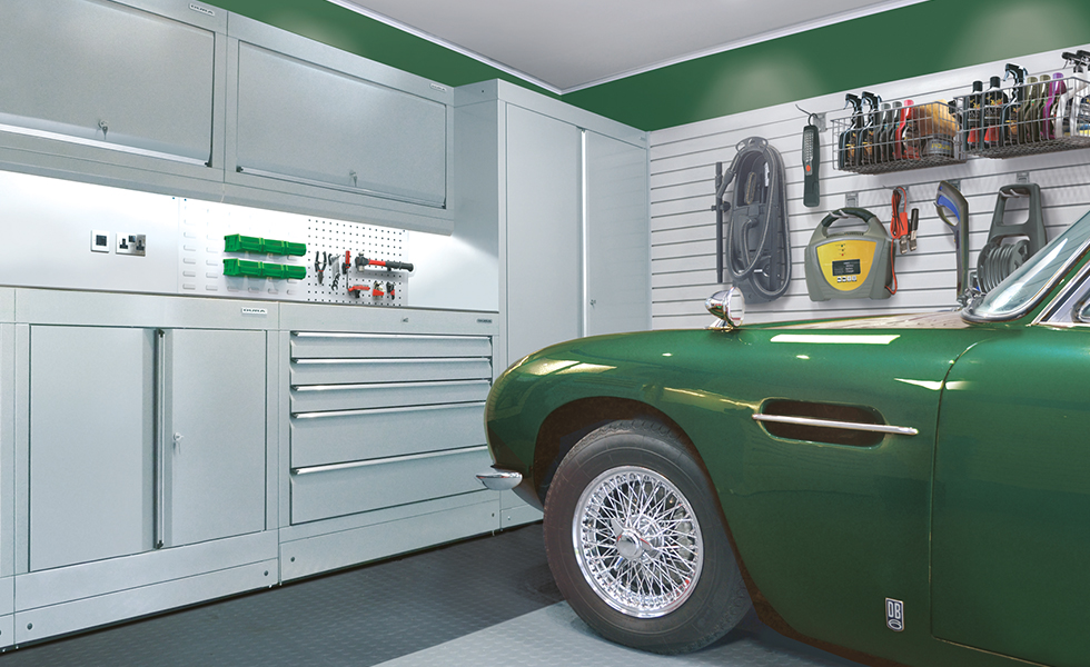 Aston Martin classic car garage with Dura cabinets, wall storage and flooring