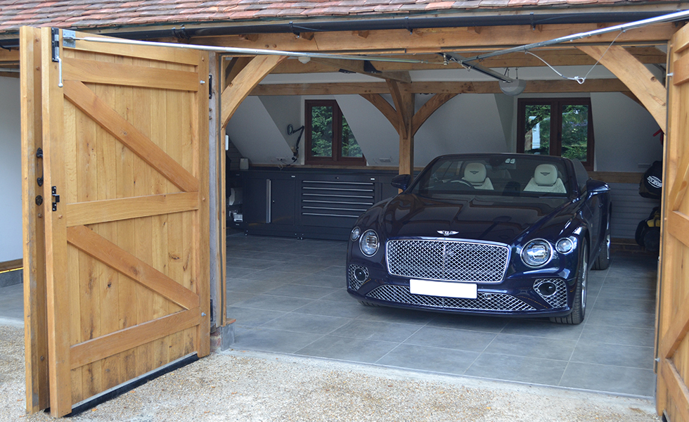 Timber frame garage with Dura cabinets for Bentley owner