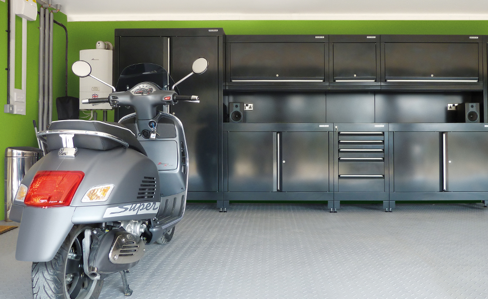 Dura garage cabinets and flooring for scooter owner