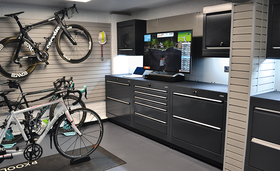 Dura cabinets, wall storage and flooring for a cycling garage