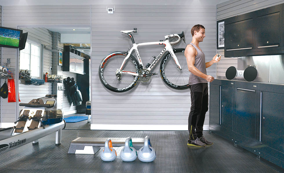 Dura cabinets, wall storage and flooring for an exercise garage