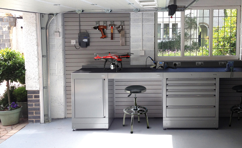 Dura home garage workshop with low level cabinets and StorePanel wall storage