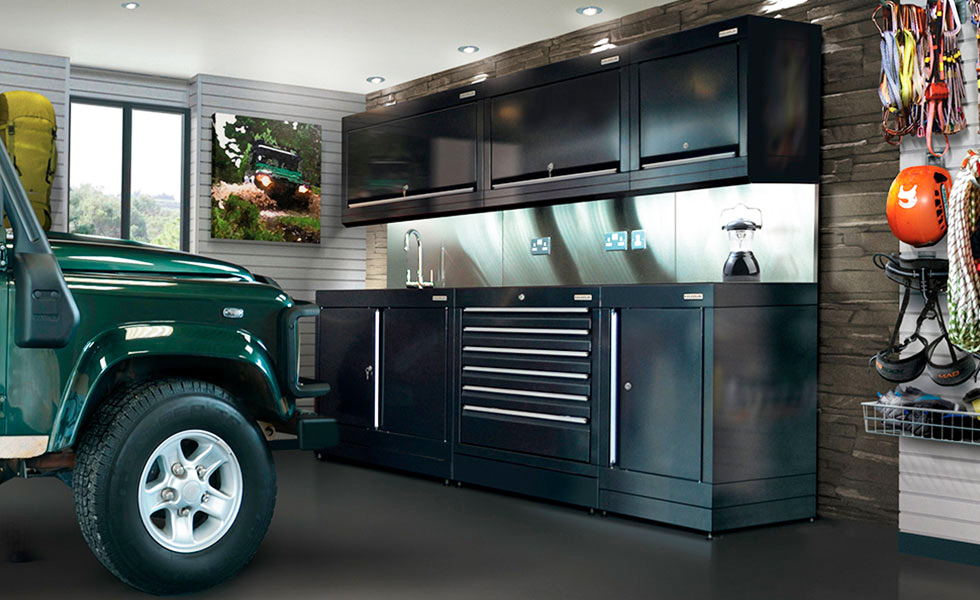 Dura cabinets and wall storage for an adventure sports garage