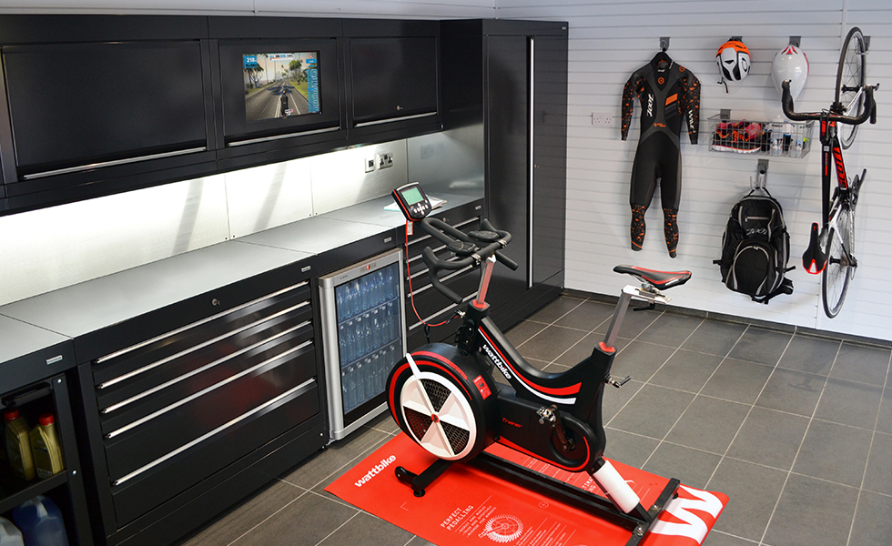 Dura cabinets and wall storage for a triathlon garage